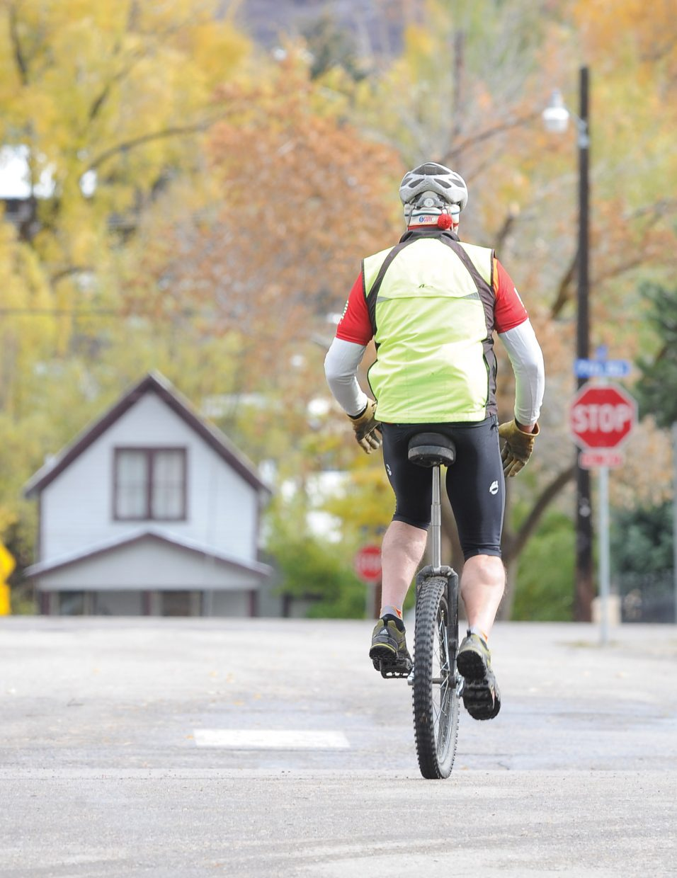 Steamboat Springs resident Bryan Alkema makes his way downtown Monday afternoon on a unicycle. Alkema said he was just trying to get his blood flowing because he's not ready for winter just yet.