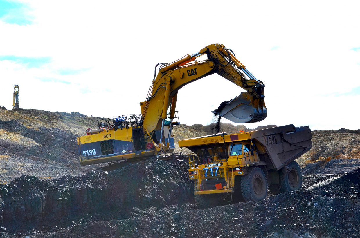 Dumping coal into a haul truck at Trapper Mine. The coal is taken to a crusher behind Craig Station to begin the process of turning it into energy.