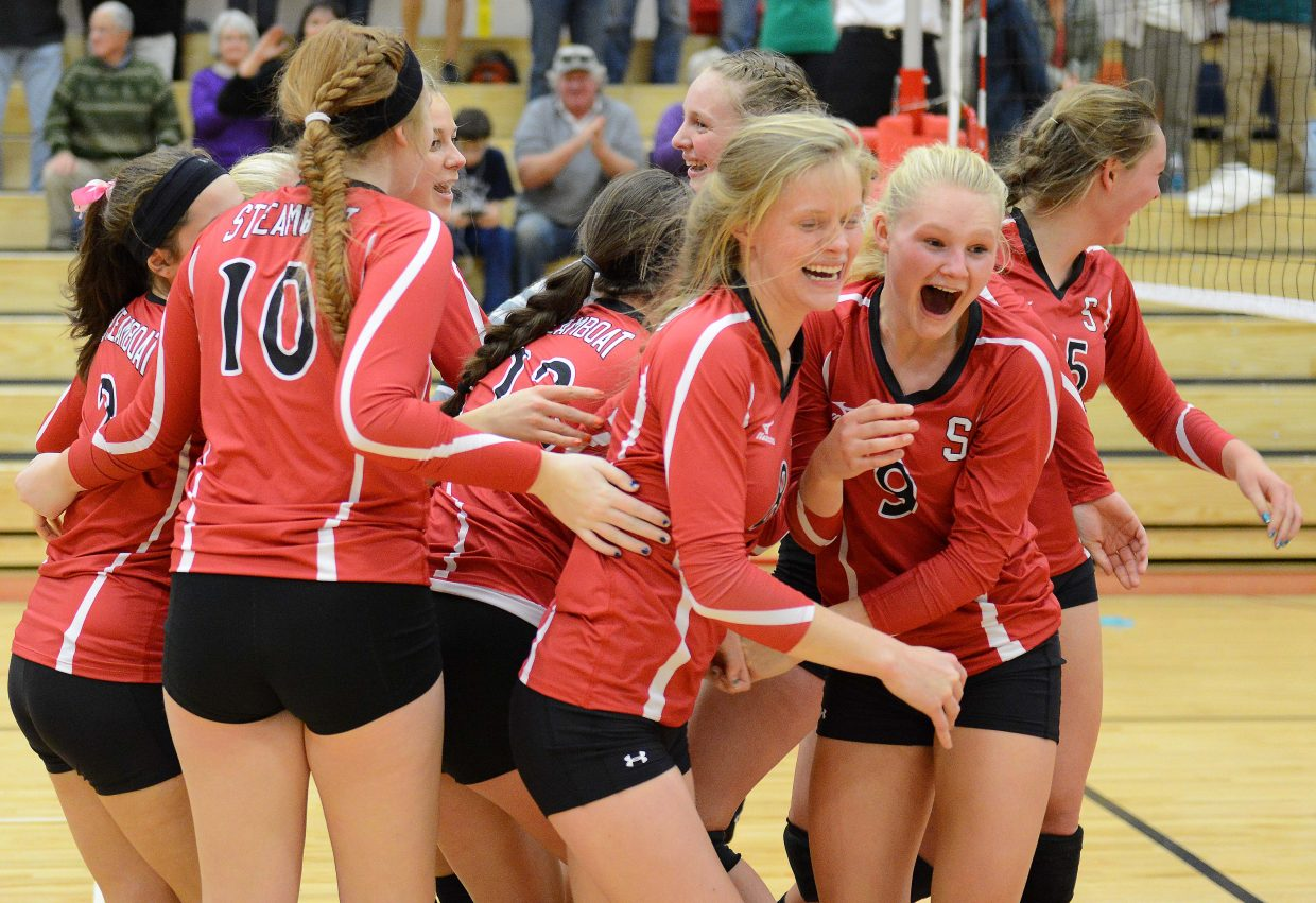 The Steamboat Springs High School volleyball team celebrates after the final point in its four-set win against Battle Mountain on Tuesday.