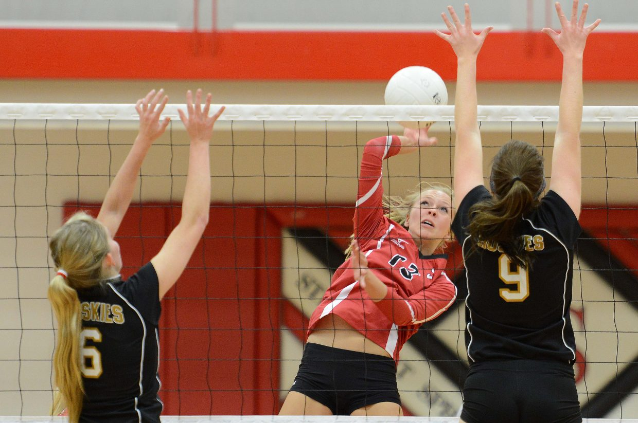 Steamboat's Erica Yaw tries to get the ball over the net Tuesday against Battle Mountain.