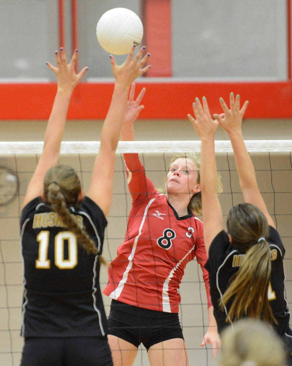 Steamboat's Riley Wilkinson taps the ball over Tuesday against Battle Mountain.