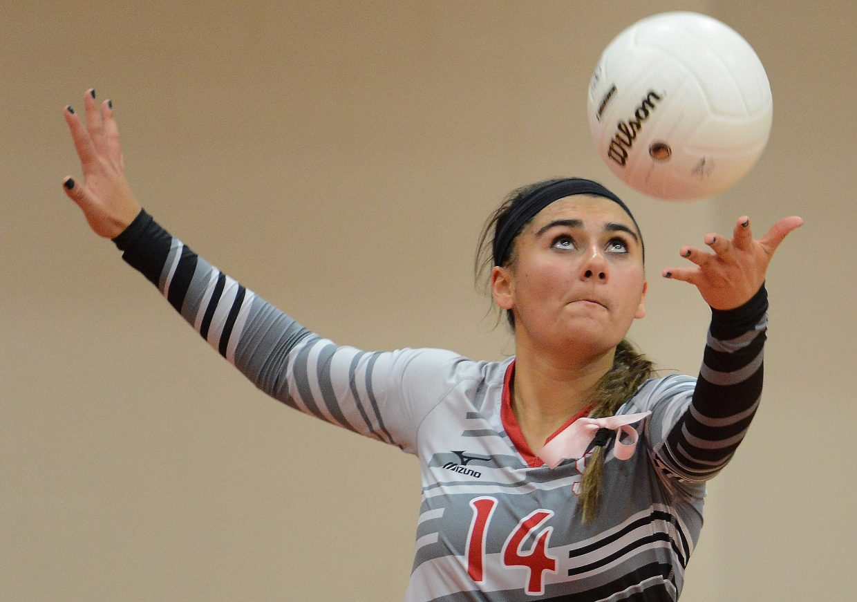 Steamboat's Maddie Labor tosses up a serve Tuesday against Battle Mountain.