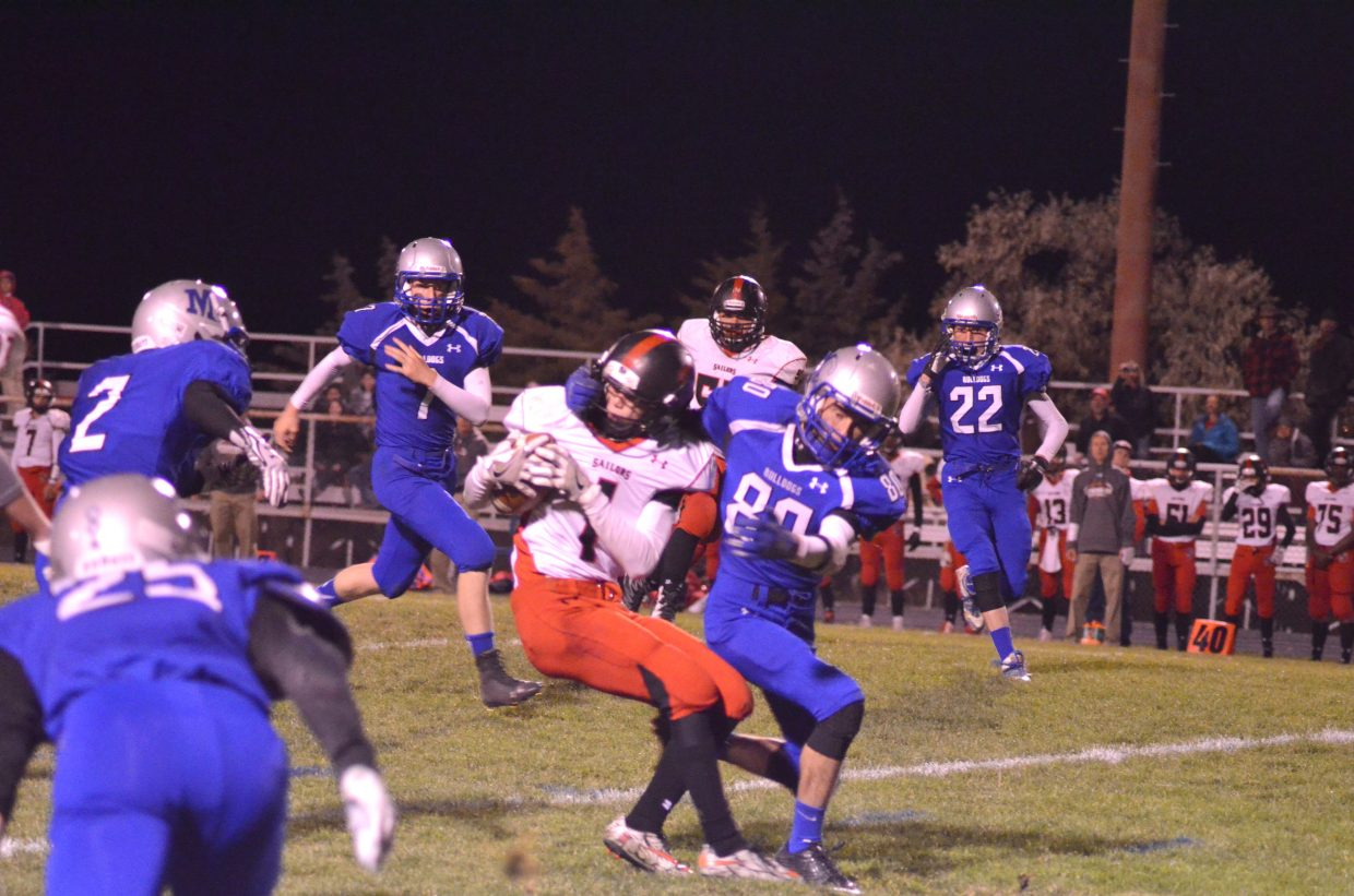 Moffat County High School's Spencer Brown works to take down Steamboat Springs' Canon Reece on the Sailor kick return during the Friday night football game in Craig between Moffat County and Steamboat. The Bulldogs won the Highway 40 rivalry game, 18-0, as part of MCHS homecoming.