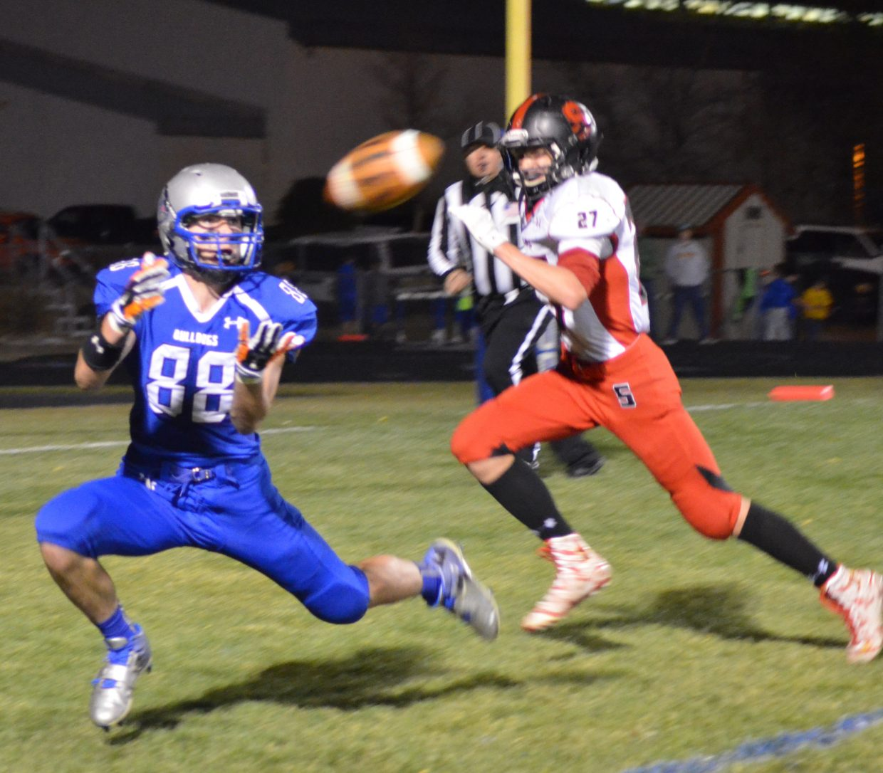 Moffat County High School's Miki Klimper welcomes a touchdown pass to give the Bulldogs their first score against Steamboat.