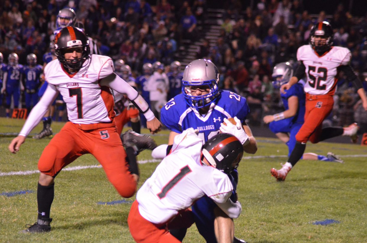 Moffat County High School's Kaden Hafey collides with Steamboat's Canon Reece during the Bulldogs-Sailors game in Craig.