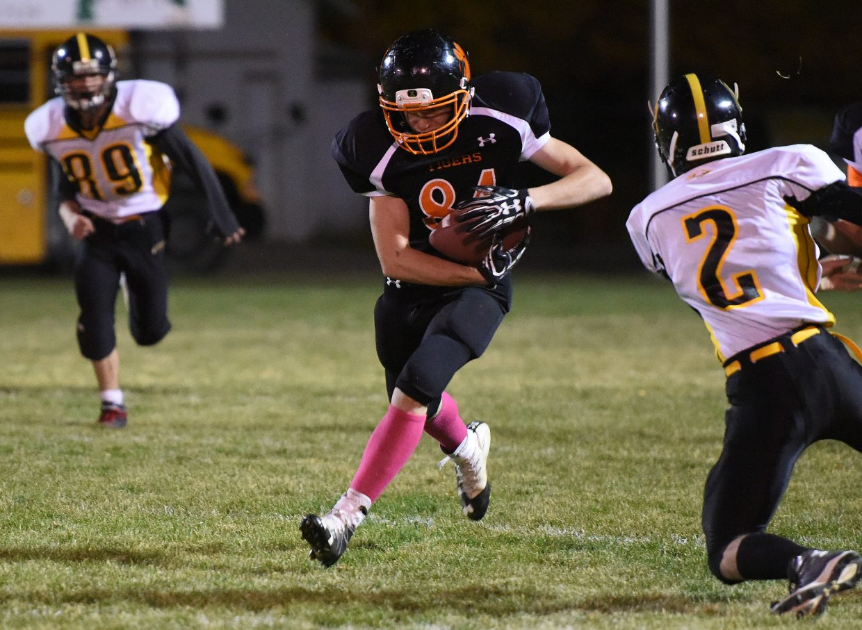 Mason Brewer flies down the field after a catch Friday against Gilpin County.