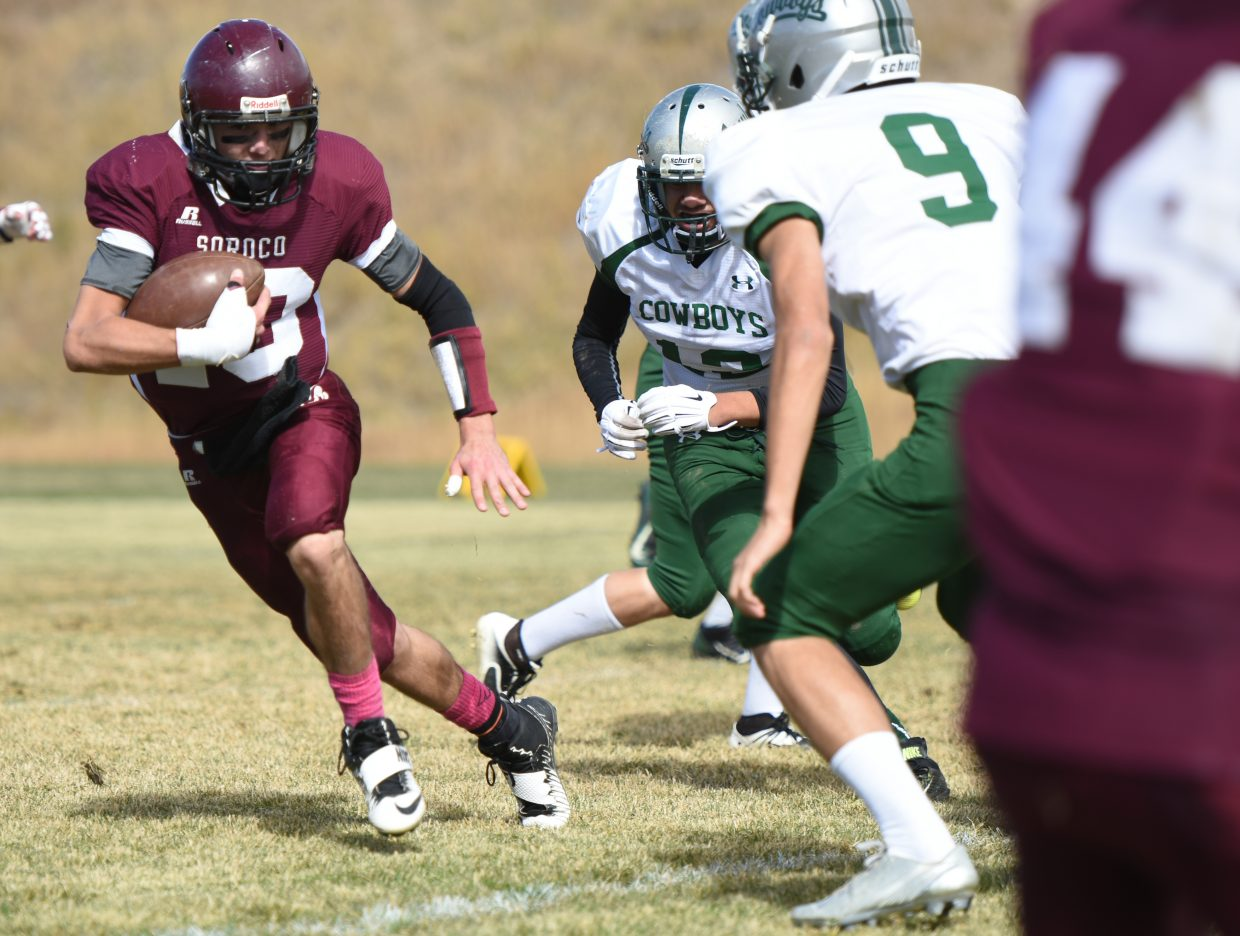 Soroco's Isaac Jonas looks for room to run Saturday against Plateau Valley.