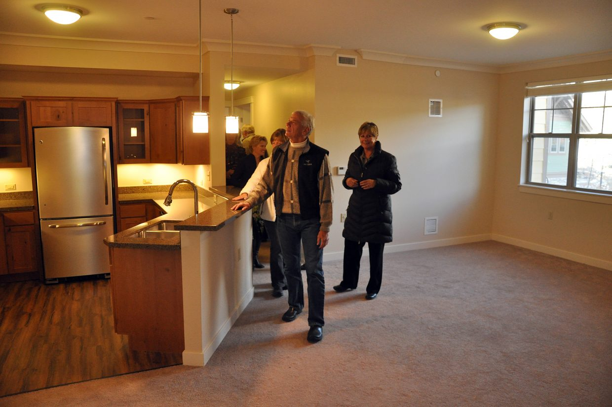 Community members check out a new residence at Casey's Pond on Wednesday night. Hundreds of people attended an open house hosted by the Steamboat Springs Chamber Resort Association at the new facility. A grand opening will be held in December.