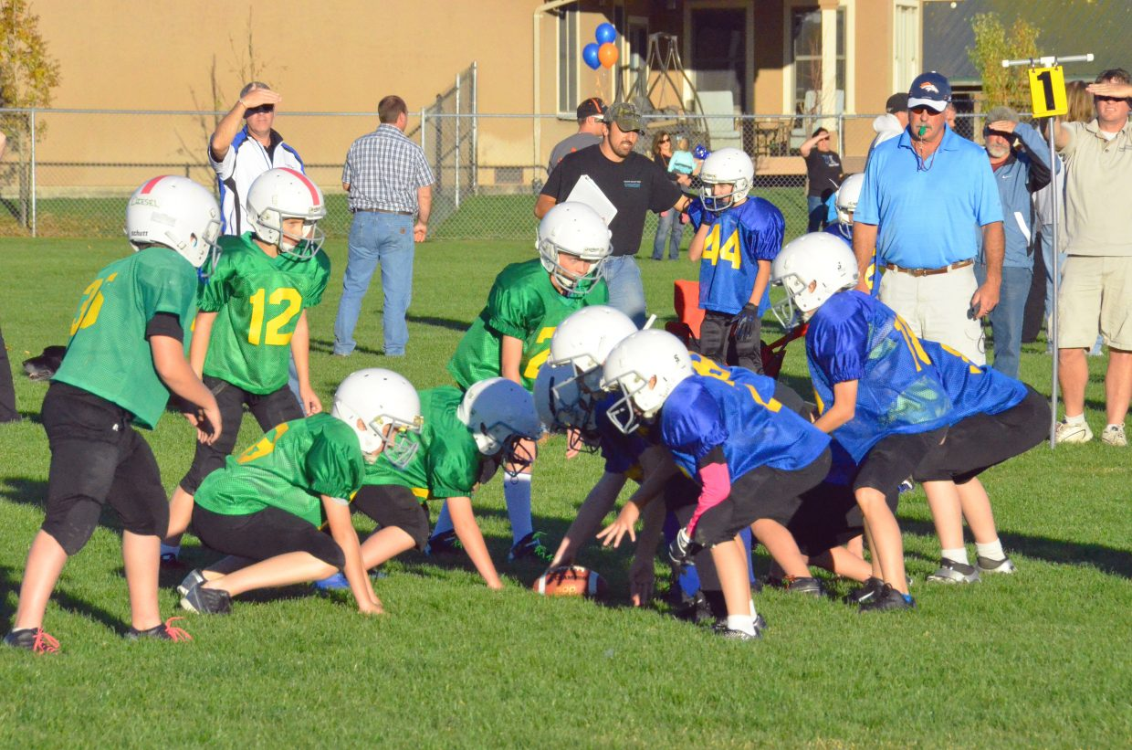 The Hertzog Photography Packers line up against the Victory Motors Chargers Tuesday at Woodbury Sports Complex. The Chargers won, 26-6, to place third in the fifth- and sixth-grade division of Doak Walker tackle football.
