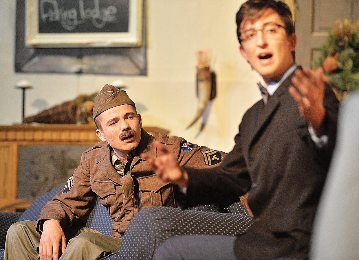 Charlie Harrington, playing Froggy, listens to Charlie, played by Charlie Tisch, in a scene from the high school play.