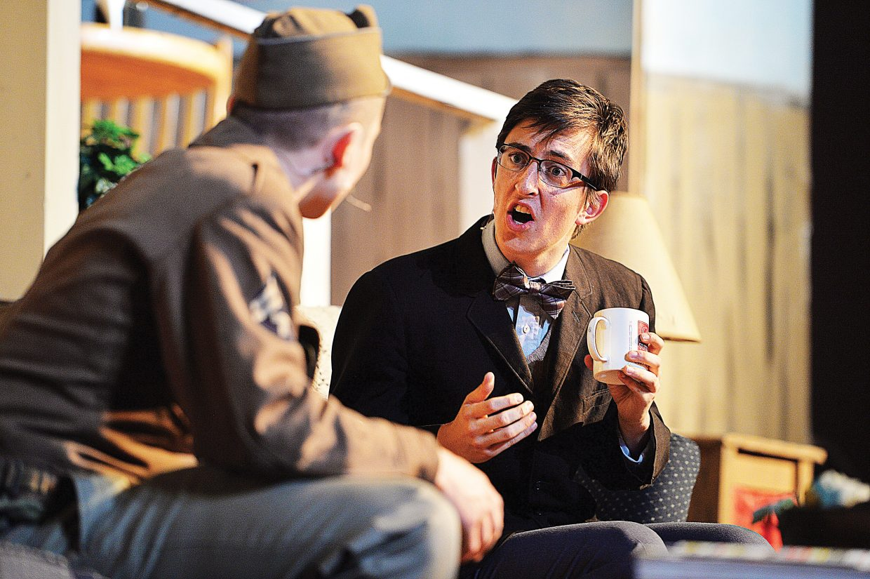 """Charlie Tisch, playing the character of Charlie Baker, talks with Charlie Harrington, playing the part of Froggy LeSueur, in a scene for the Steamboat Springs High School's production of """"The Foreigner."""