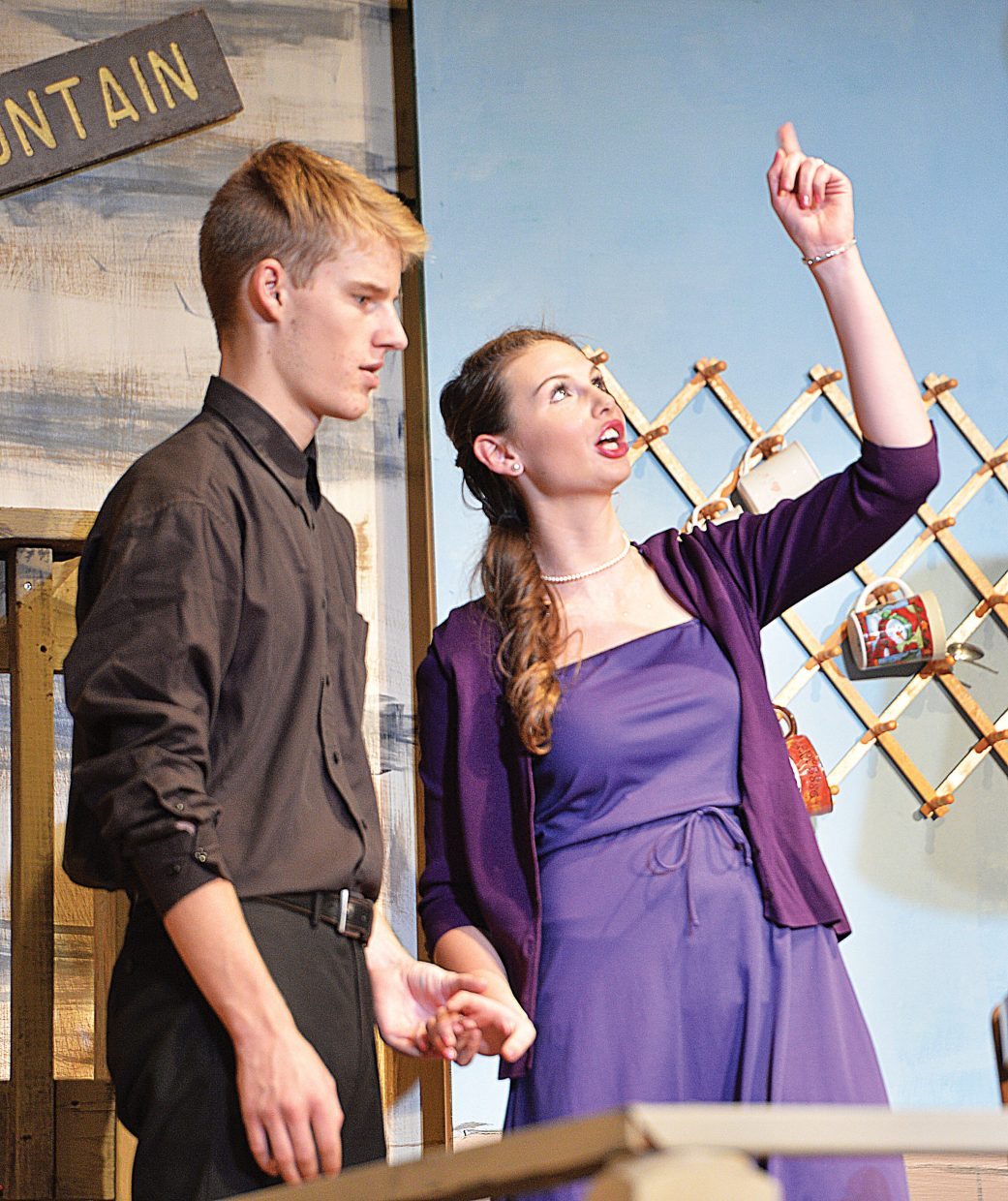 """Alec Koepfer, playing the part of David Marshall Lee, shares a scene with Catherine Simms, played by McKendrey McGown, in the Steamboat Springs High School's production of """"The Foreigner."""