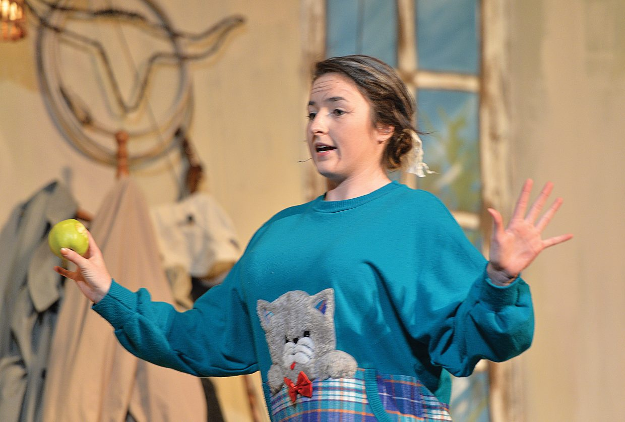 """Maggie Carrigan plays the part of Betty Meeks in a scene for the Steamboat Springs High School's production of """"The Foreigner."""""""