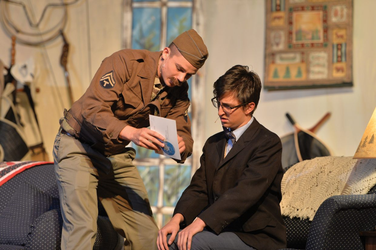 """Charlie Tisch, playing the character of Charlie Baker, talks with Charlie Harrington, playing the part of Froggy LeSueur, in a scene for the Steamboat Springs High School's production of """"The Foreigner."""""""