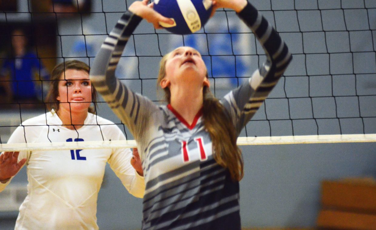 Moffat County High School senior Alex Samuelson readies her defense as Steamboat Springs' Annie Osbourn puts up a set in the Lady Bulldogs' 3-1 loss Thursday night at MCHS. Moffat County will travel to Parachute this weekend to meet Grand Valley High School.