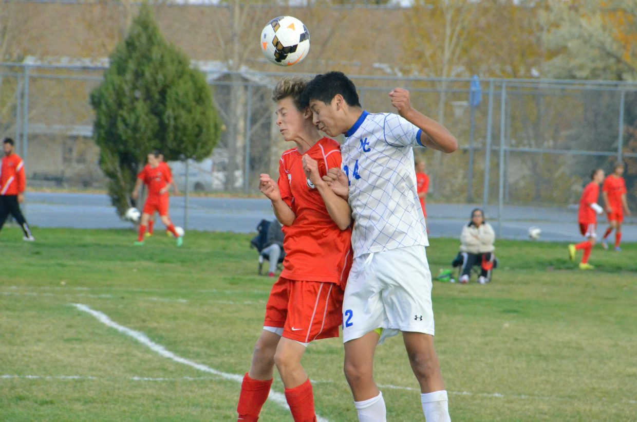 Steamboat Springs High School's Will Beurskens, left, and Moffat County High School's Luis Lopez go head to head to get to the ball at midfield during the Bulldogs' varsity soccer game against the Sailors Thursday in Craig. Steamboat won, 2-0, to finish the season 9-5-1 overall, while MCHS went 3-11-1 this year.