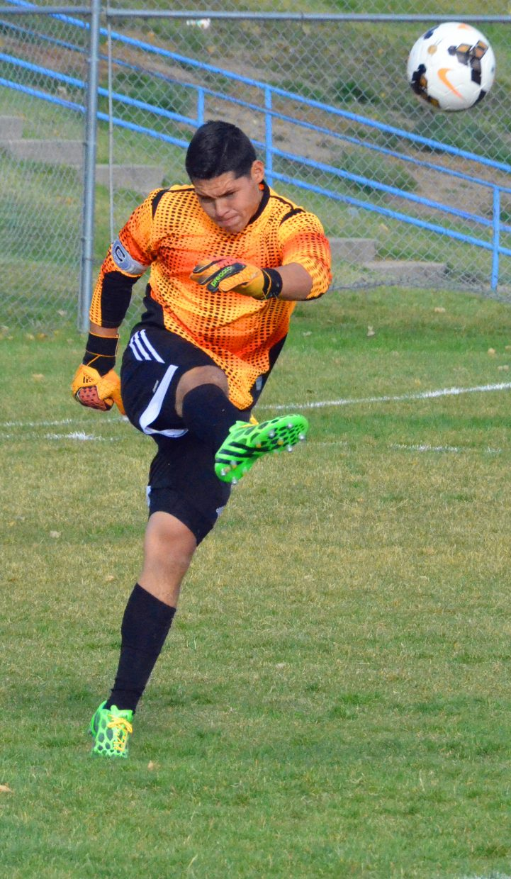 Moffat County High School's goalie Alex Arellano boots the ball back into play during the Bulldogs' varsity soccer game against the Steamboat Springs Sailors Thursday in Craig. Arellano was one of nine MCHS seniors to finish his high school career this week.