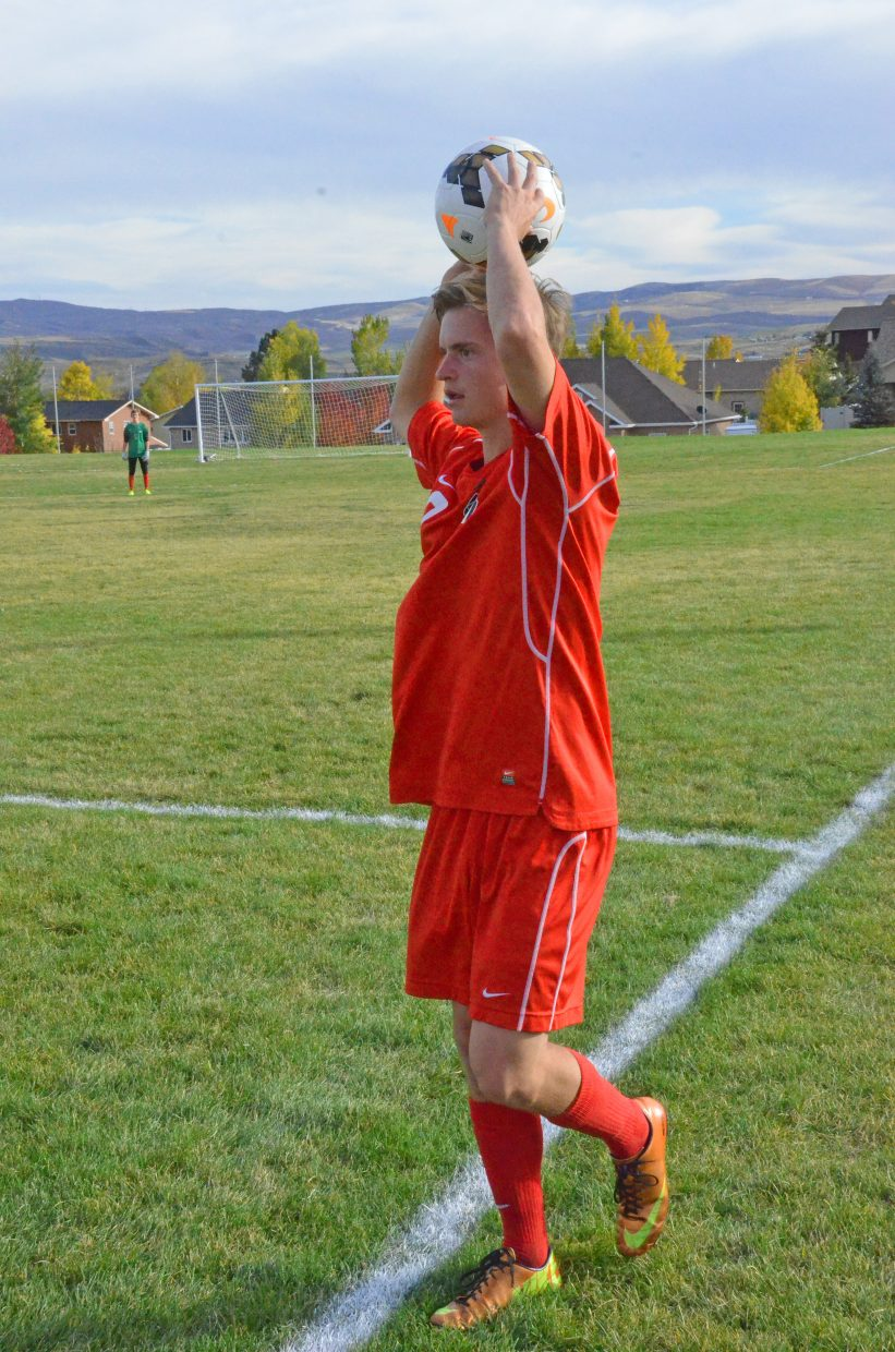 Steamboat Springs High School's Devin de Jong scans the field for a teammate to throw in to at the soccer field at Moffat County High School during the Sailors' Thursday game in Craig. After ending the season, Steamboat is seeking an at-large bid for the playoffs.