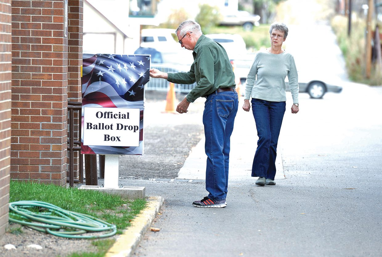 Gary DeKoter drops off his mail-in ballot while walking past the Routt County Courthouse in downtown Steamboat on Wednesday with his wife, Linda. Routt County Clerk and Recorder Kay Weinland said the drop-off box has been a popular option for voters already this election season, and on the first day she saw a large number of ballots dropped off outside the courthouse. The box is placed in the alley between the old courthouse and the annex building. Voters can walk up, drive up or ride up to drop off ballots. On Monday, Weinland said the voter services and polling center also would open in the annex building. The station will be open from 8:30 a.m. to 4:30 p.m. weekdays, and from 10 a.m. to 3 p.m. Oct. 25 and Nov. 1 to help voters. Weinland said voters will be able to change addresses, register to vote and make ballot requests. They also will be able to vote and drop off ballots in this the first partisan mail-in election in the state of Colorado.