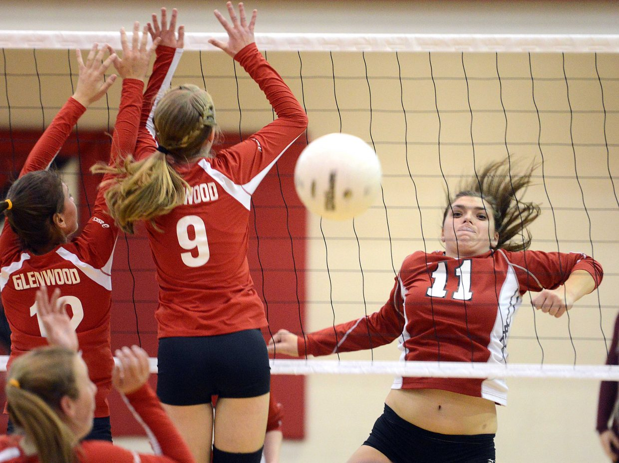 Maddie Roberston watches as a kill sails over the net Thursday against Glenwood Springs.