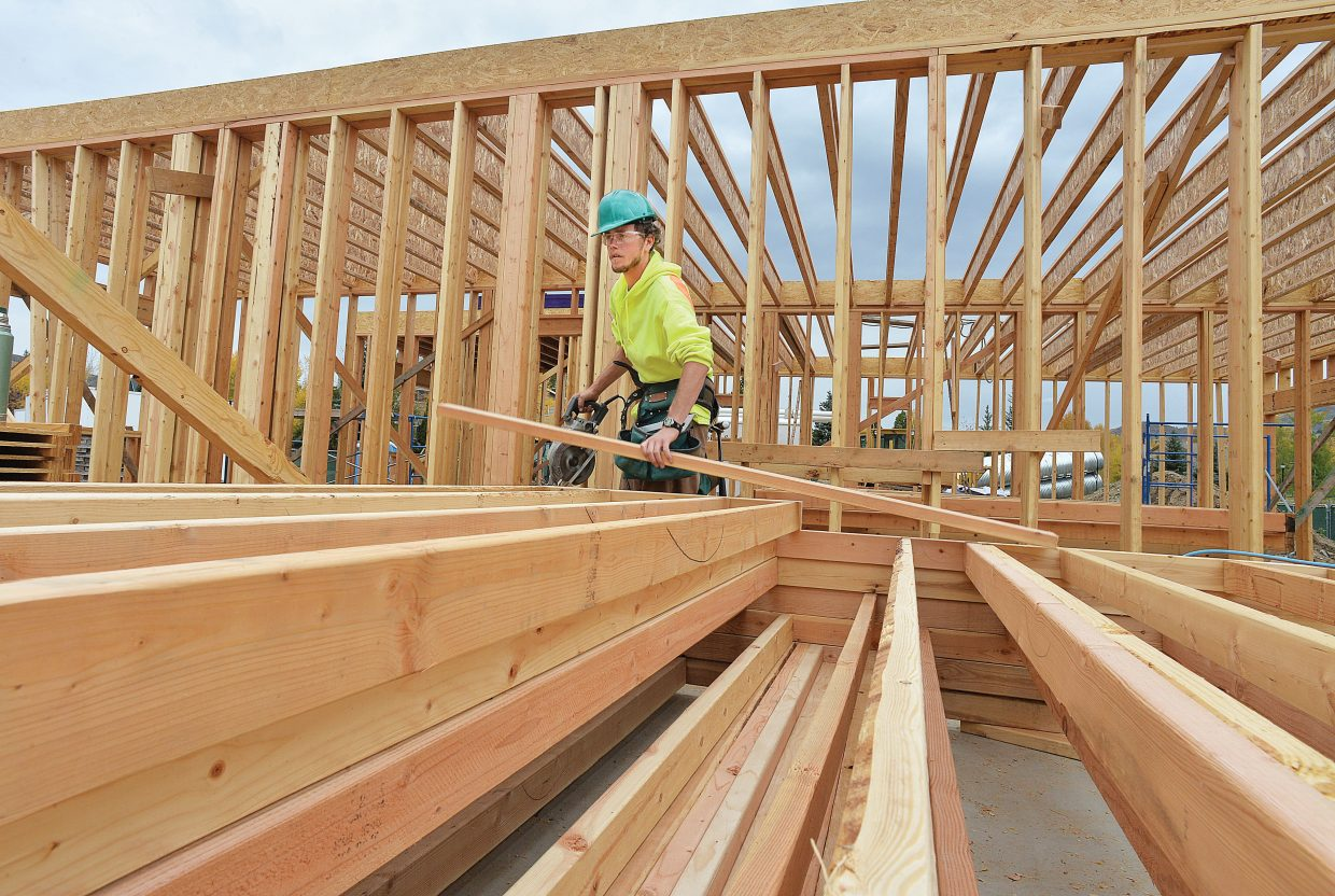 Construction worker Jordan Register works on the new Ski View apartment complex at the corner of Whistler Road and Skyview Lane in Steamboat Springs.