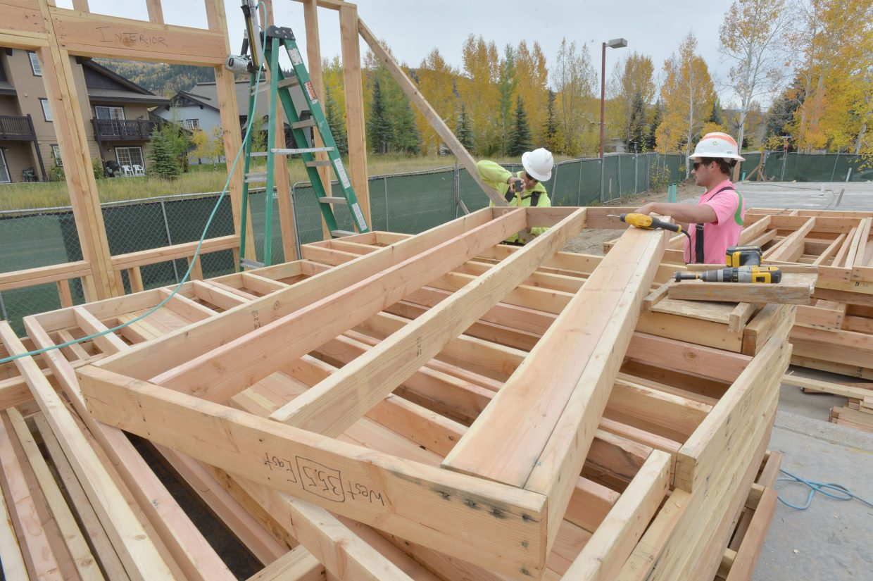 Jacob LaPlant, left, and Blaine Bulger work on framing the new Ski View apartment complex at the corner of Whistler Road and Skyview Lane in Steamboat Springs.