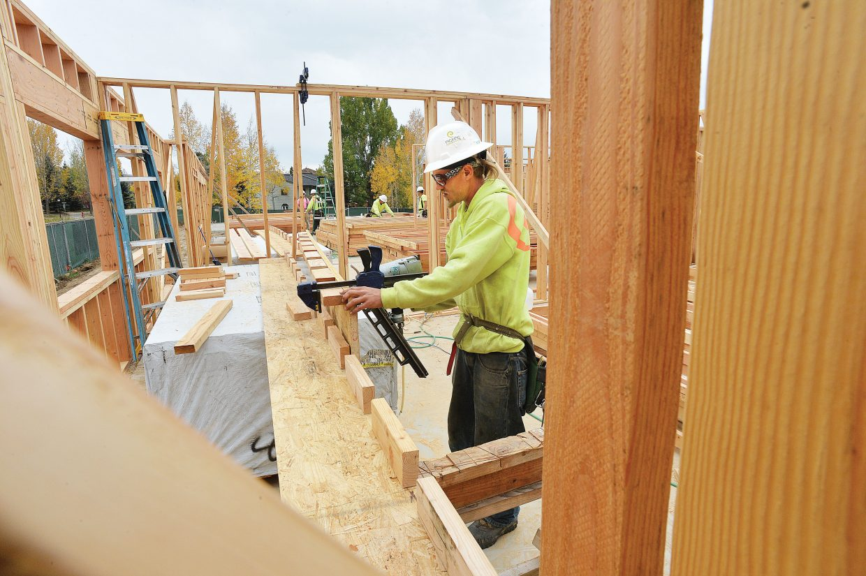 Construction worker Daniel Hallstrom works on the new Ski View apartment building at the corner of Whistler Road and Skyview Lane in Steamboat Springs.