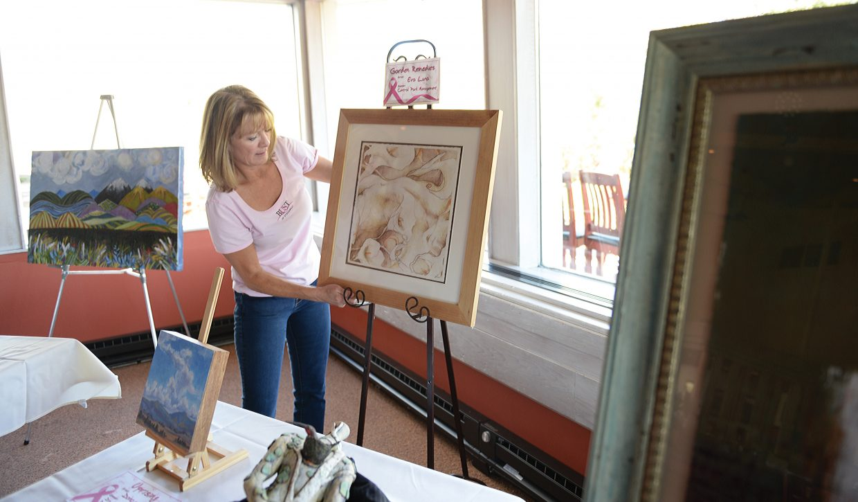 Debbie Curd, founder of the Yampa Valley Breast Cancer Awareness Project, sets up prior to the 2015 Bust of Steamboat event.