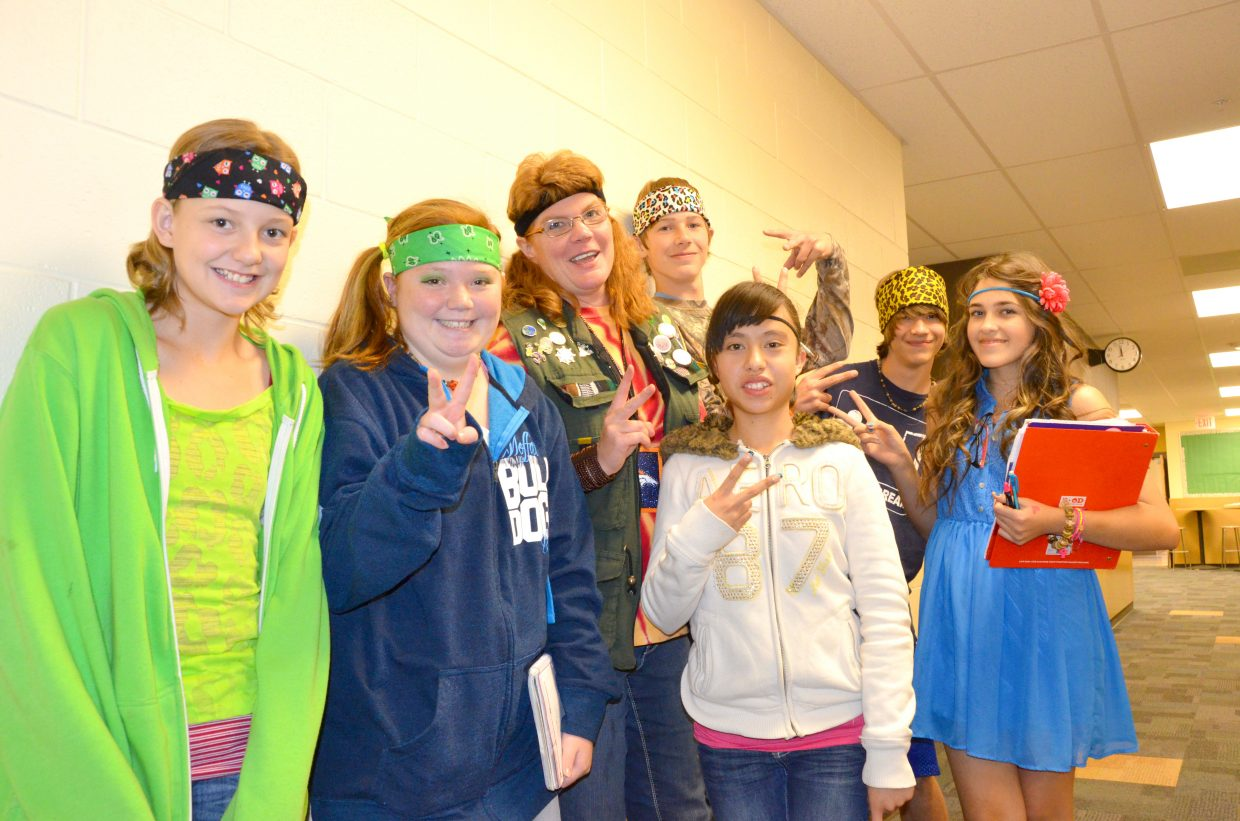 Craig Middle School teacher Alicia Townsend and her students wear 1960s-style regalia during the school's Homecoming week Dress Like a Hippie or Redneck Day.