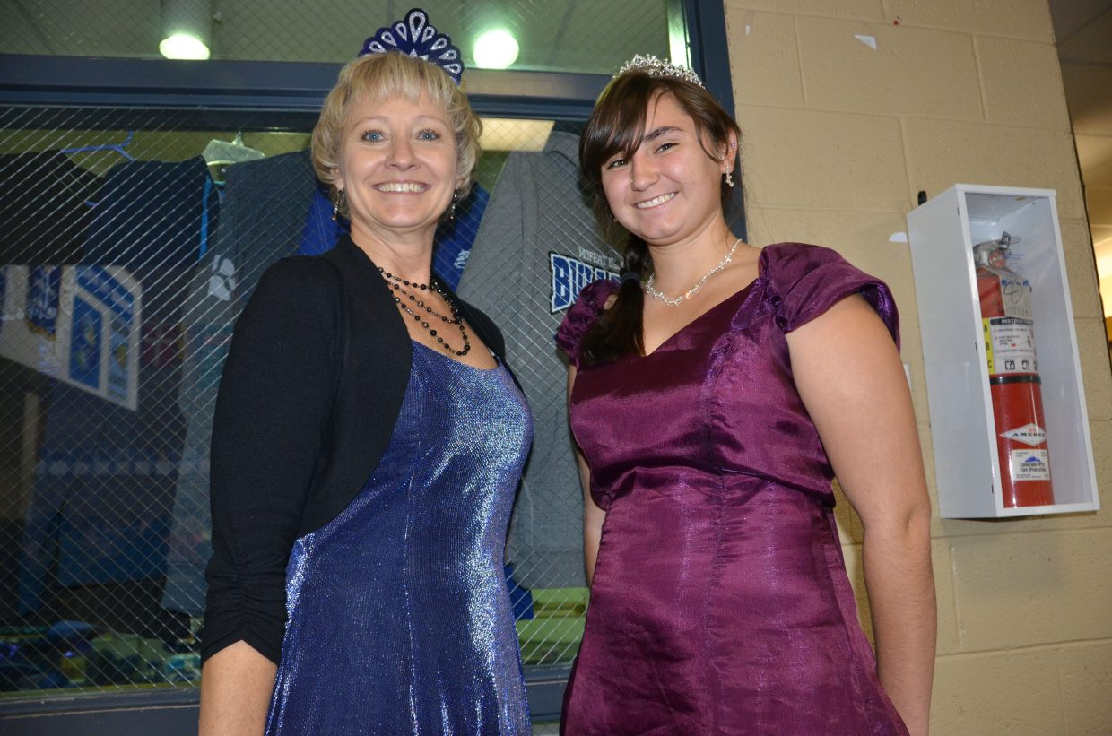 Moffat County High School teacher Deb Markham, left, and MCHS junior Tonie Valentine proudly wear their regal get-ups during Homecoming week's Prince/Princess Day. Both students and faculty dressed up during the week's events.