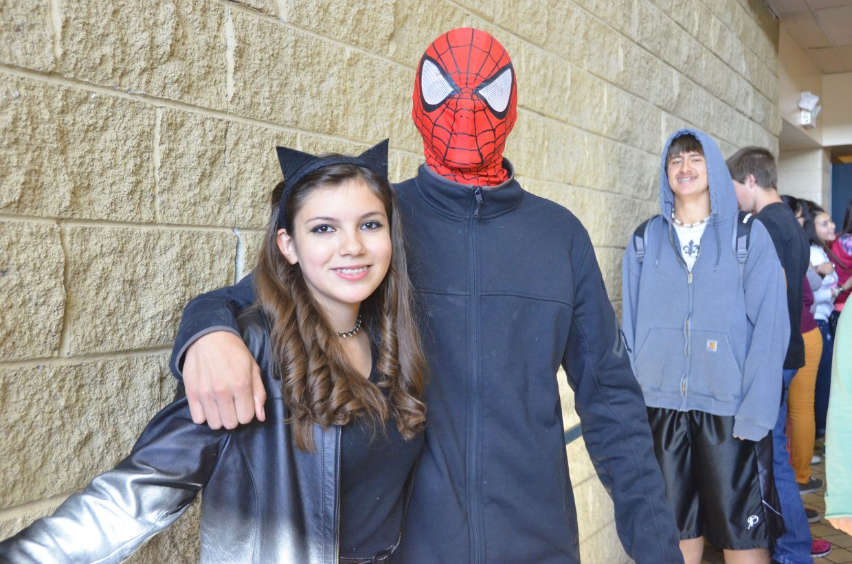 Moffat County High School sophomore Mary Liz Ramos, left, and freshman Michael Hough wear the costumes of Catwoman and Spider-Man as part of Homecoming week's Superhero/Supervillain Day.