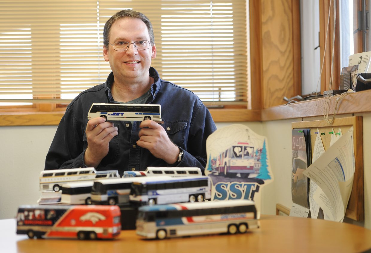 Steamboat Springs Transit Manager Jonathan Flint, pictured in his office with just a small portion of his model bus collection, has worked for the city since 1990.