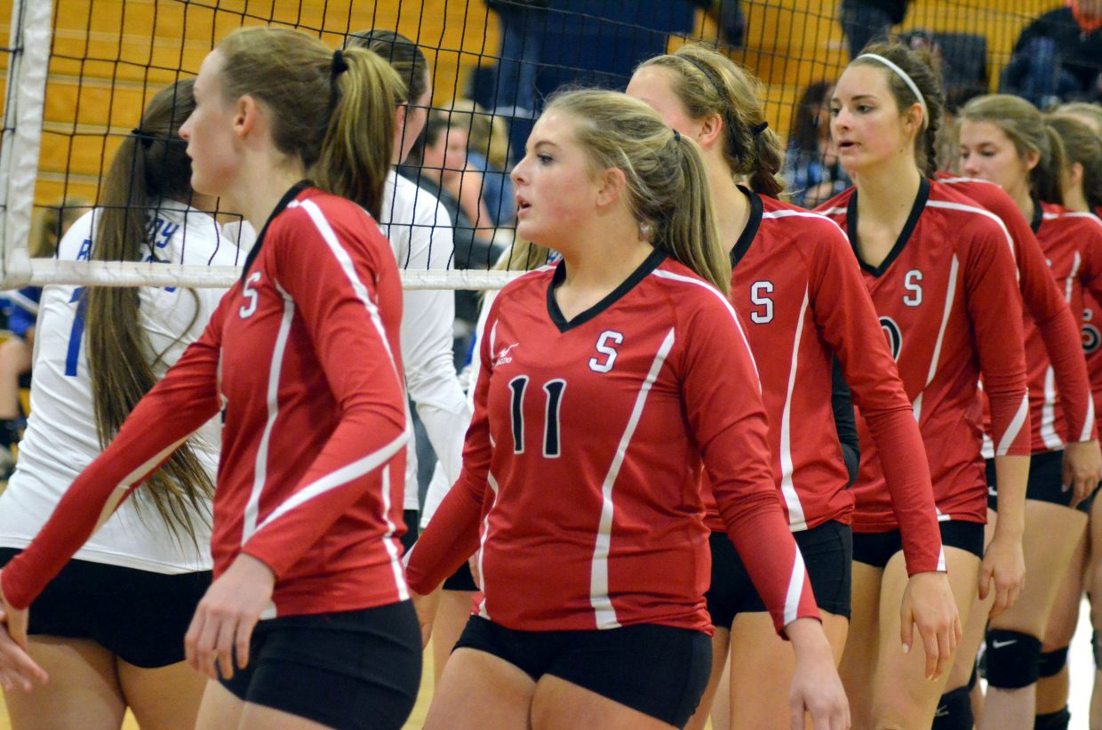 Steamboat Springs volleyball players congratulate Moffat County rivals on a game well played Monday night in Craig.