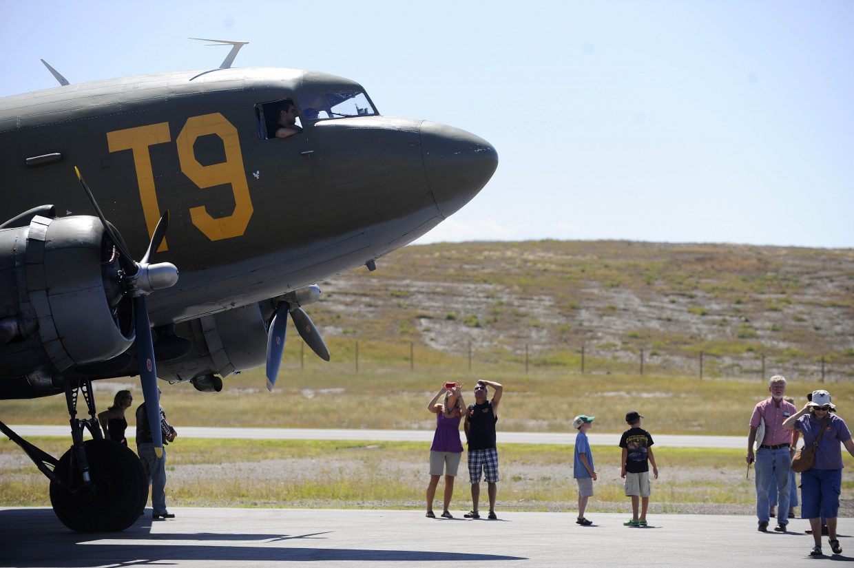 Passengers unload after taking a ride on the Douglas C-47 Skytrain military transport aircraft at the Wild West Air Fest at Steamboat Springs Airport during Labor Day weekend in 2011. Summer air service again has become a topic of interest for Steamboat as dissatisfaction with the reliability of the current daily flight to Denver has mounted.