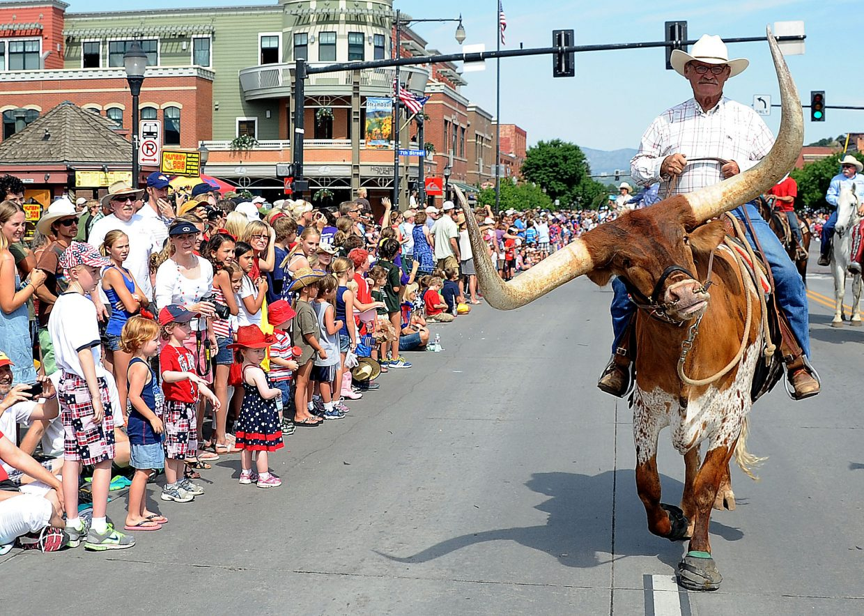 Wes Hatch and Redneck rumble down Lincoln Avenue with the Steamboat Springs Pro Rodeo Series group in the 2012 Fourth of July parade in downtown Steamboat Springs.