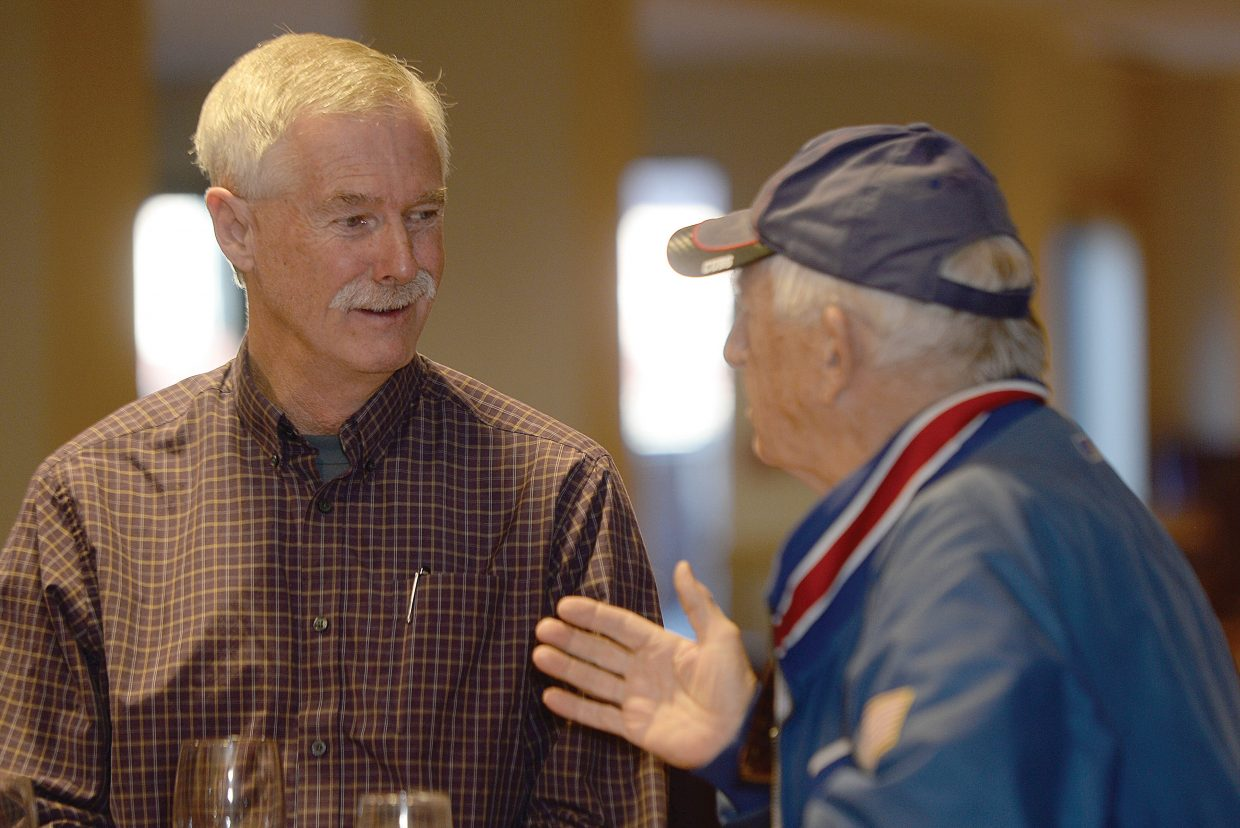 Tim Corrigan visits with a constituent during a meet-and-greet session prior to Thursday's 2016 Election Forum, which was sponsored by Steamboat Pilot & Today, the Steamboat Springs Board of Realtors, Routt County Republicans and Routt County Democrats. Corrigan, a Democrat, is running against Republican Bob Dapper for Routt County commissioner in District 1.