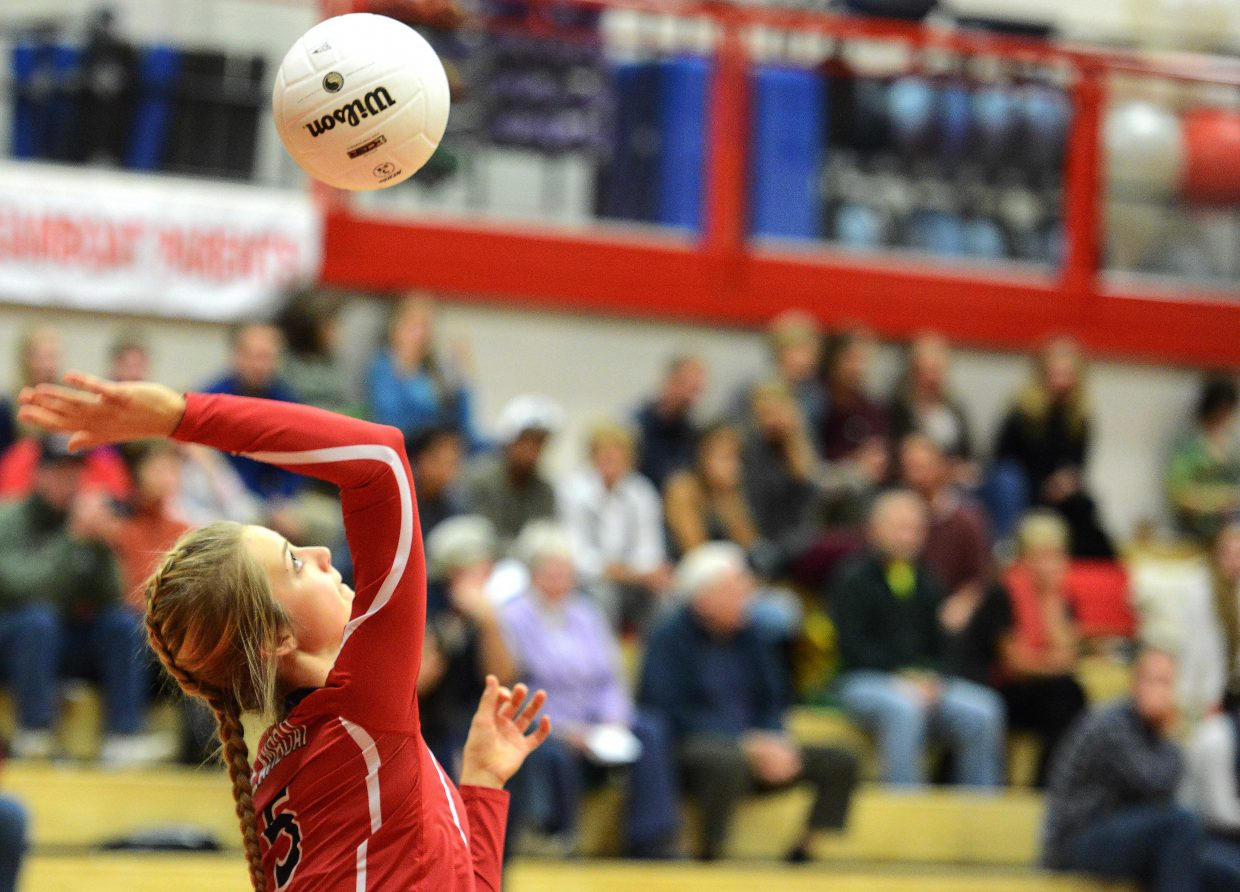 Steamboat senior Taylor Harrington sends in a serve Tuesday against Rifle. Harrington helped lead the Sailors to a lopsided win at home.