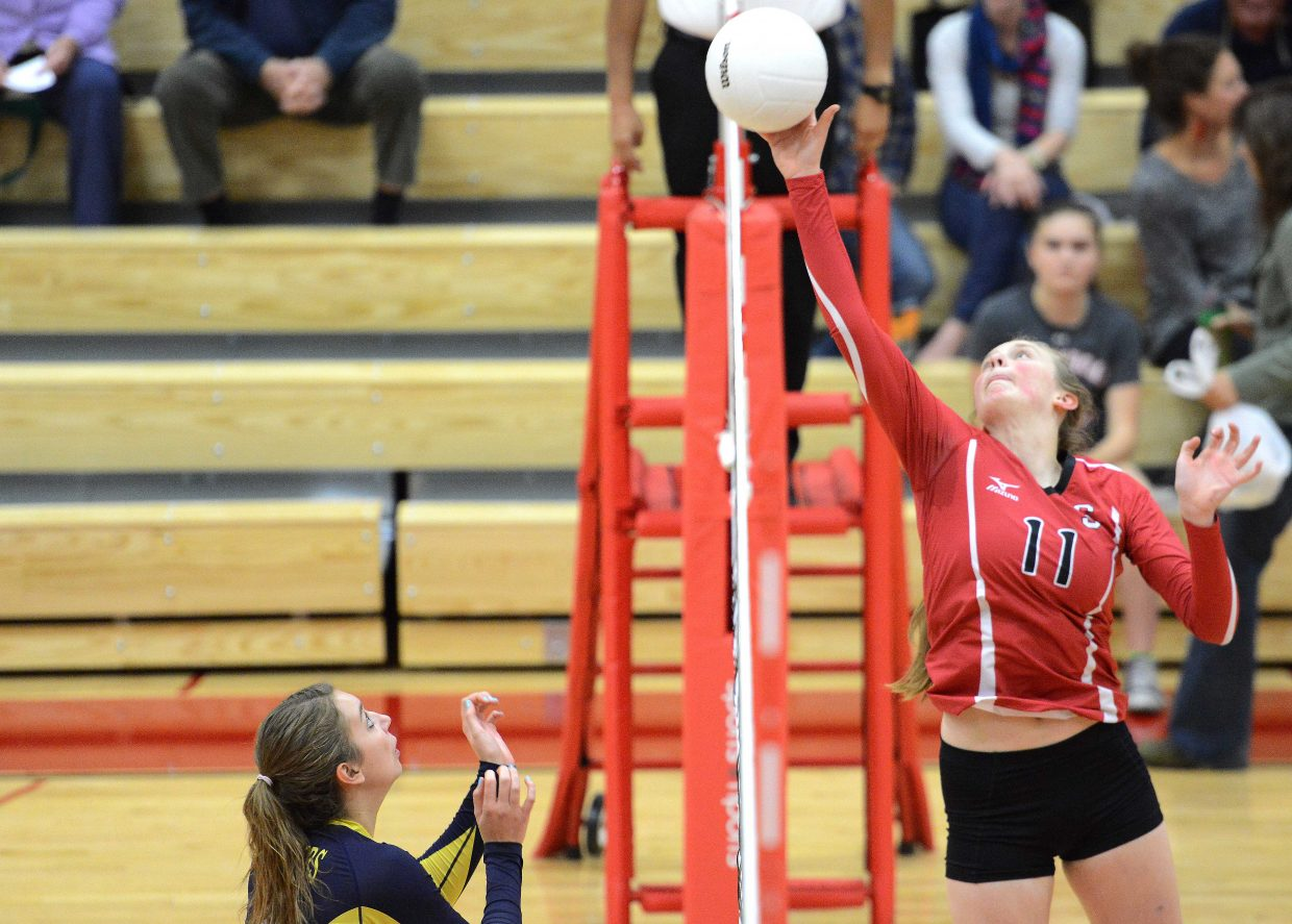 Steamboat's Annie Osbourn tips the ball over the net Tuesday.
