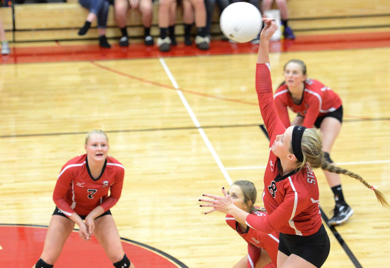 Steamboat's Riley Wilkinson swings for a kill Tuesday against Rifle.