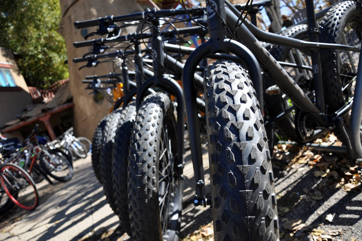 Fat bikes are stocked outside Orange Peel Bicycle Service on Tuesday afternoon. Howelsen Hill and Lake Catamount will allow the bikes on groomed cross-country trails this winter.