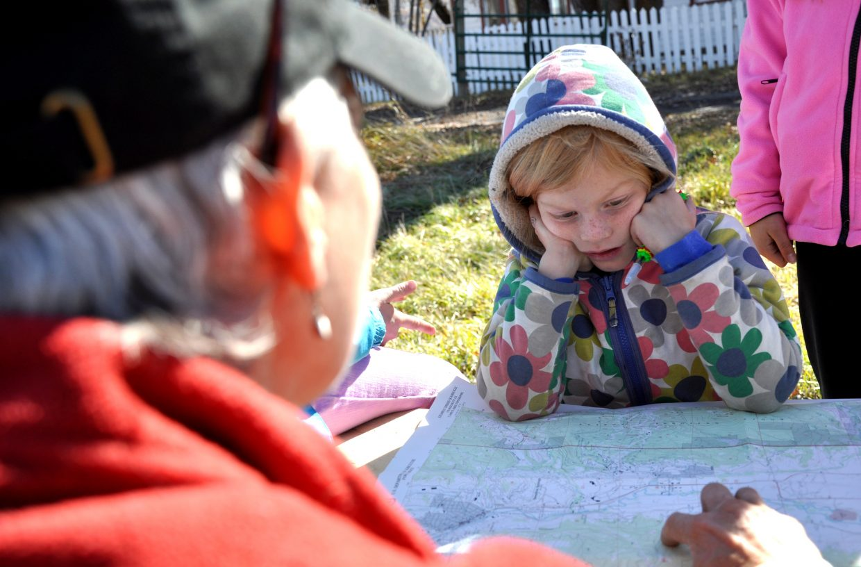 Soda Creek Elementary School third-grader Abbie Boyce watches as Yampatika naturalist Karen Vail teaches her how to read a topographic map Tuesday afternoon at Legacy Ranch. The lesson was part of Yampatika's Environmental Literacy Program, which will reach 42 classrooms this year.