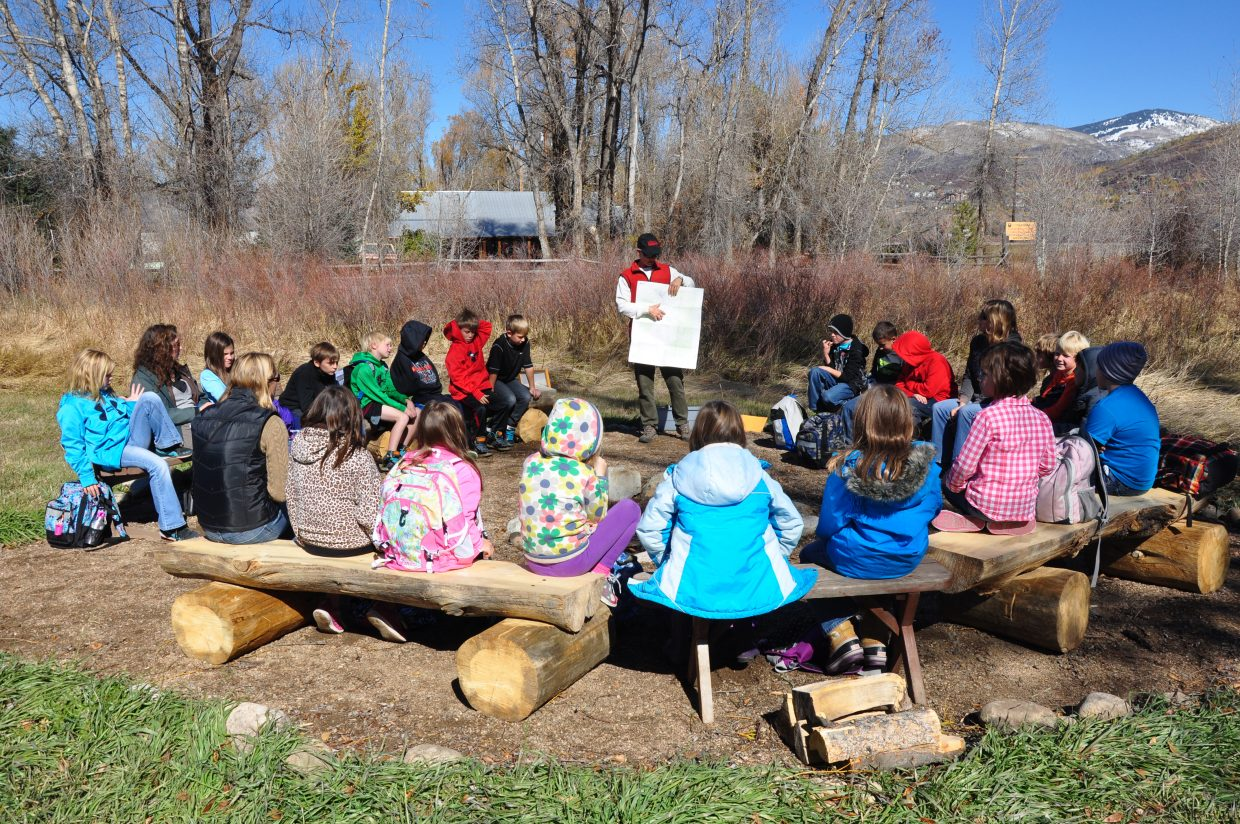 Yampatika Naturalist Karen Vail teaches Soda Creek Elementary School students how to read a topographic map.