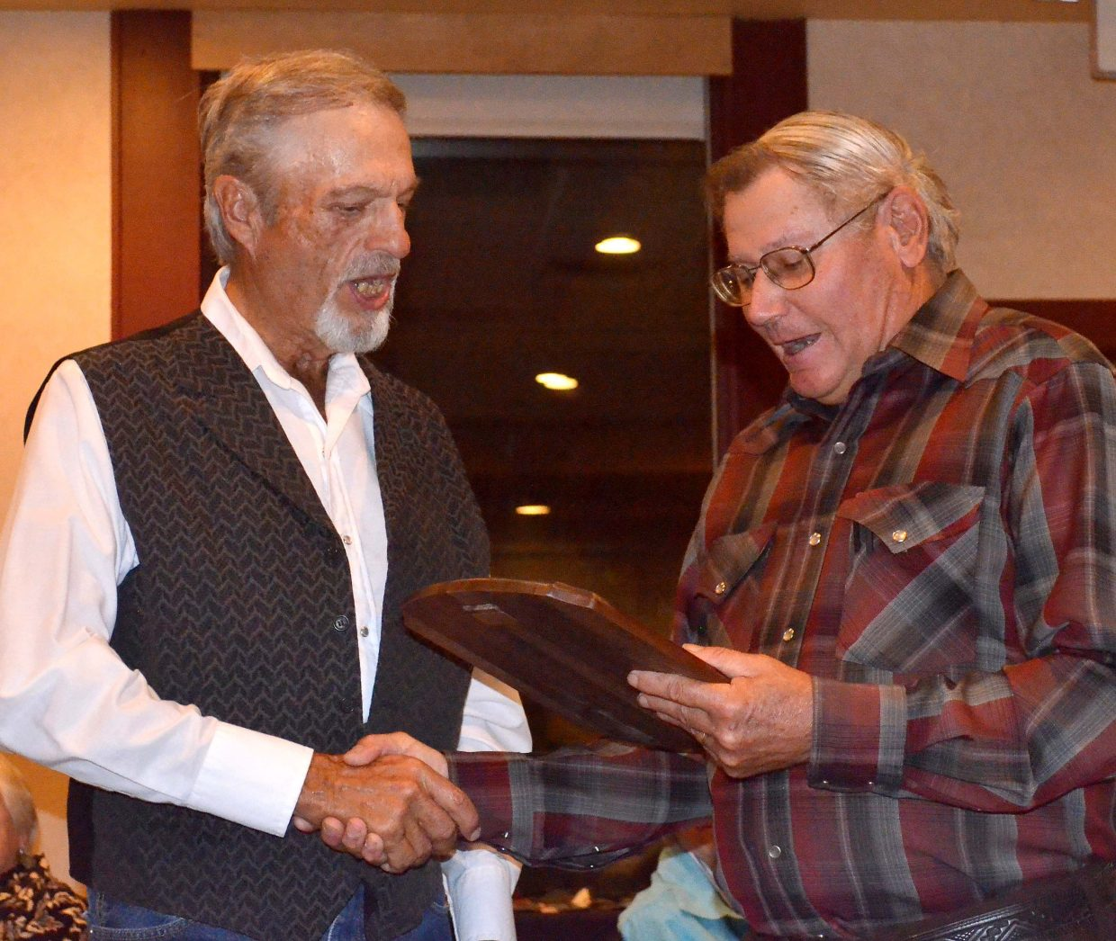 Pleasant Valley rancher Bill Gay, left, receives the Leckenby Award from Jim Stanko, representing the Tread of Pioneers Museum.