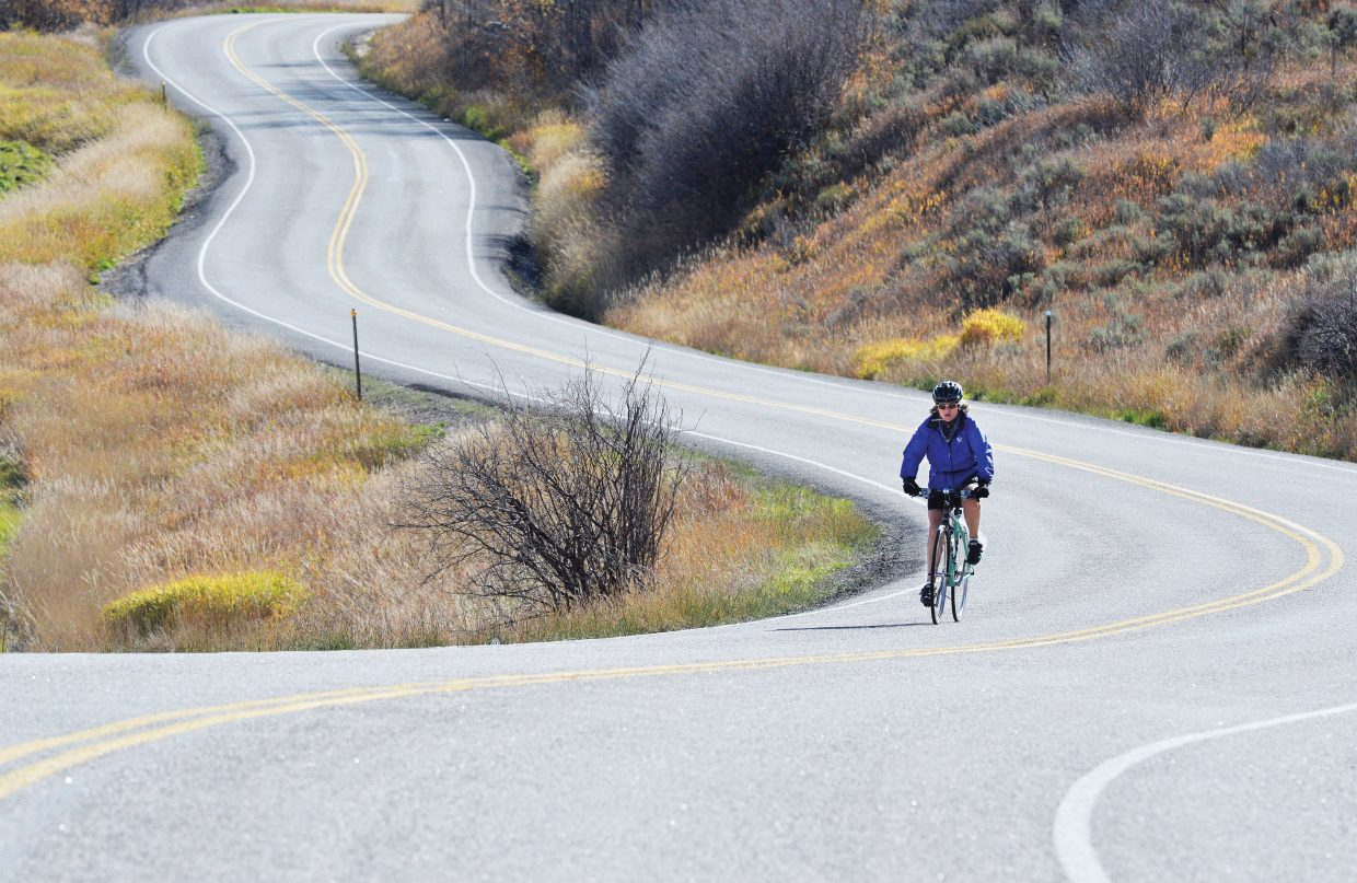 Cyclist Kathy Moser makes her way along Routt County Road 14 south of Steamboat Springs on Wednesday afternoon.
