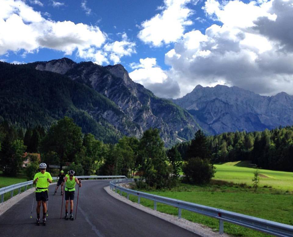 U.S. Nordic combined skiers work their way up a road in the Alps while training this fall in Europe.