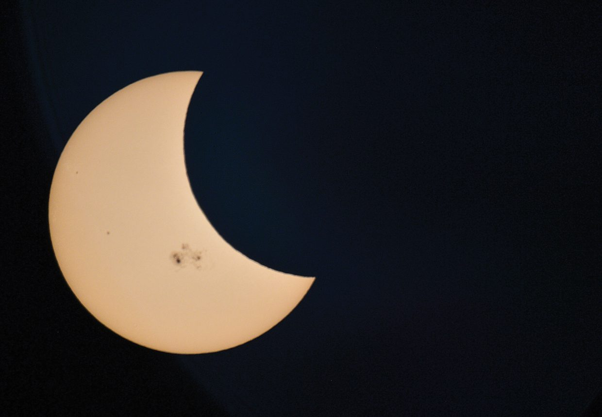 The moon moves between the Earth and the sun Thursday afternoon during a partial solar eclipse, which could be seen through special telescopes in Steamboat Springs. Jimmy Westlake a professor who teaches astronomy and physics at Colorado Mountain College, warns people to never look directly at the sun.