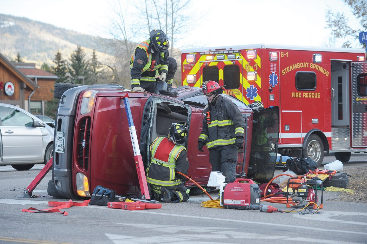 Steamboat Springs Fire Rescue respond to a two-car crash at Anglers Drive and U.S. Highway 40 Thursday night.
