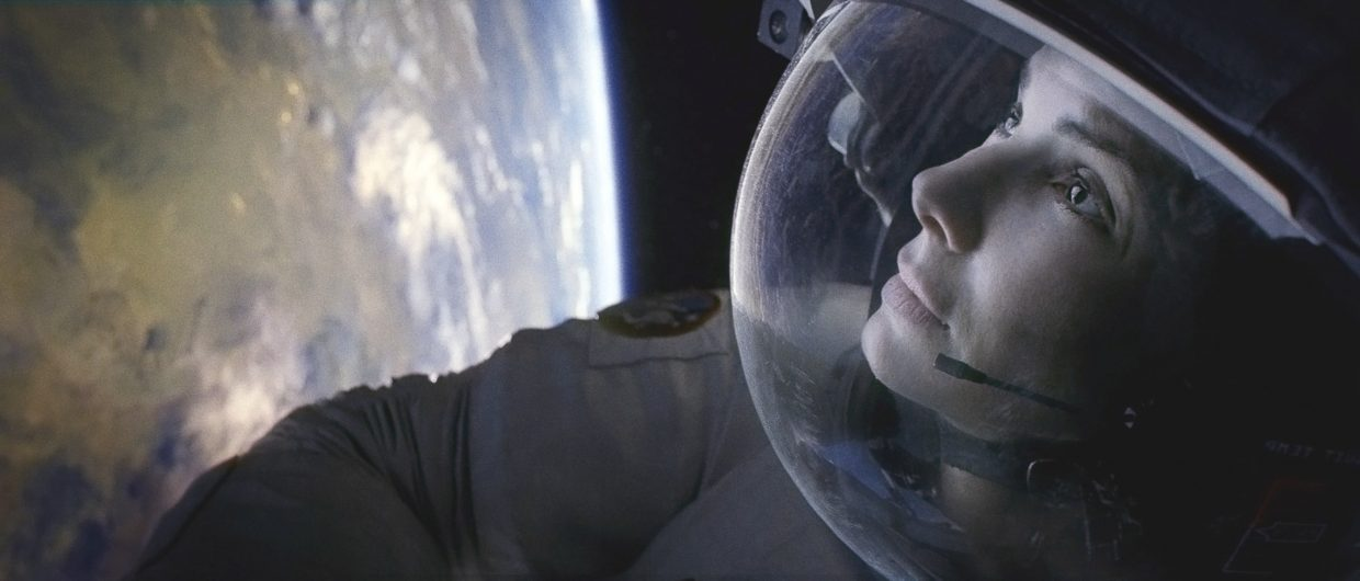 "Ryan Stone (Sandra Bullock) looks into the nothingness of space in ""Gravity."" The movie is about two astronauts who must fight to stay alive in space when their equipment is destroyed unexpectedly."