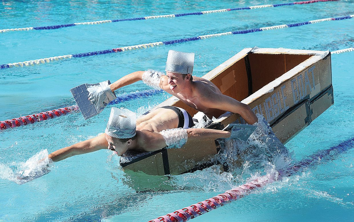 David Kidd, front, and Devin De Jong race across the Old Town Hot Springs pool Friday morning during the Cardboard Classic. The races featured physics students and their vessels from Steamboat Springs High School and South Routt.