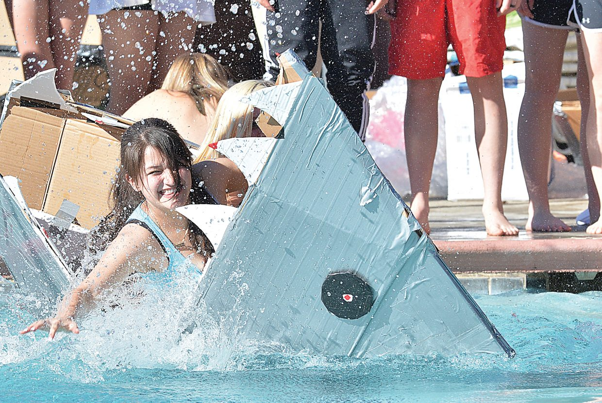 """It may have looked like a scene from """"Jaws"""" at the Old Town Hot Springs Pool on Friday morning, but Steamboat Springs junior Flor Miranda, (shown in the sharks mouth) and her teammate Emily Groves were unable to take a bite out of the competition when it came to making it across the pool in the annual Cardboard Classic. The vessel did manage to finish in a tie for most creative. Good thing the judging took place before the competition."""